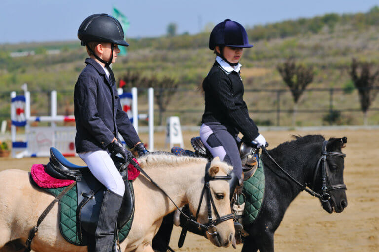 Boy and girl in jumping show