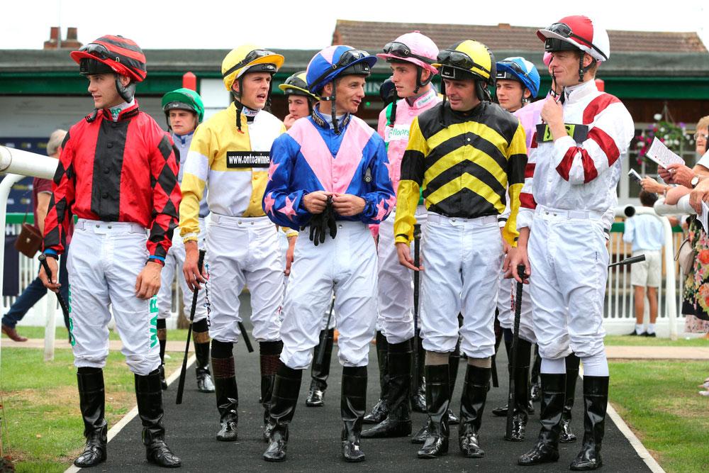 Jockeys enter the Parade Ring