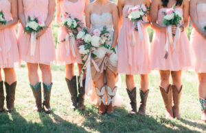 bride and mades of honor in cowboy boots