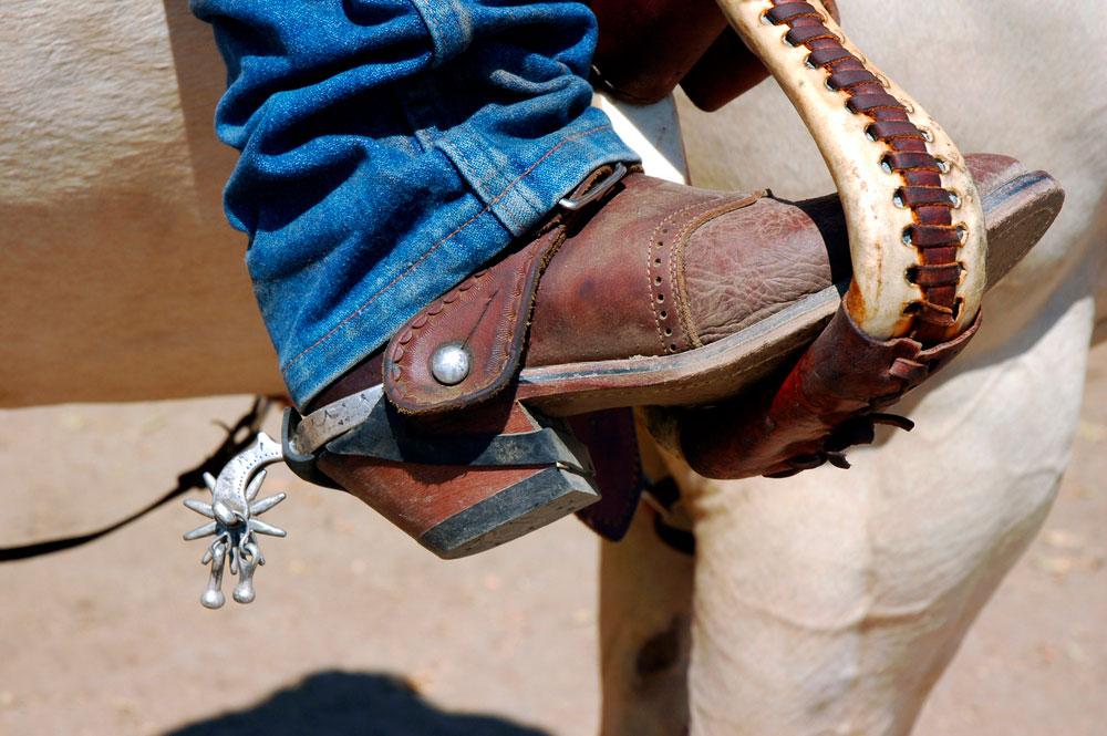 cowboy boot on angled stirrup