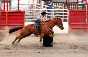 cowgirl competing in a barrel race