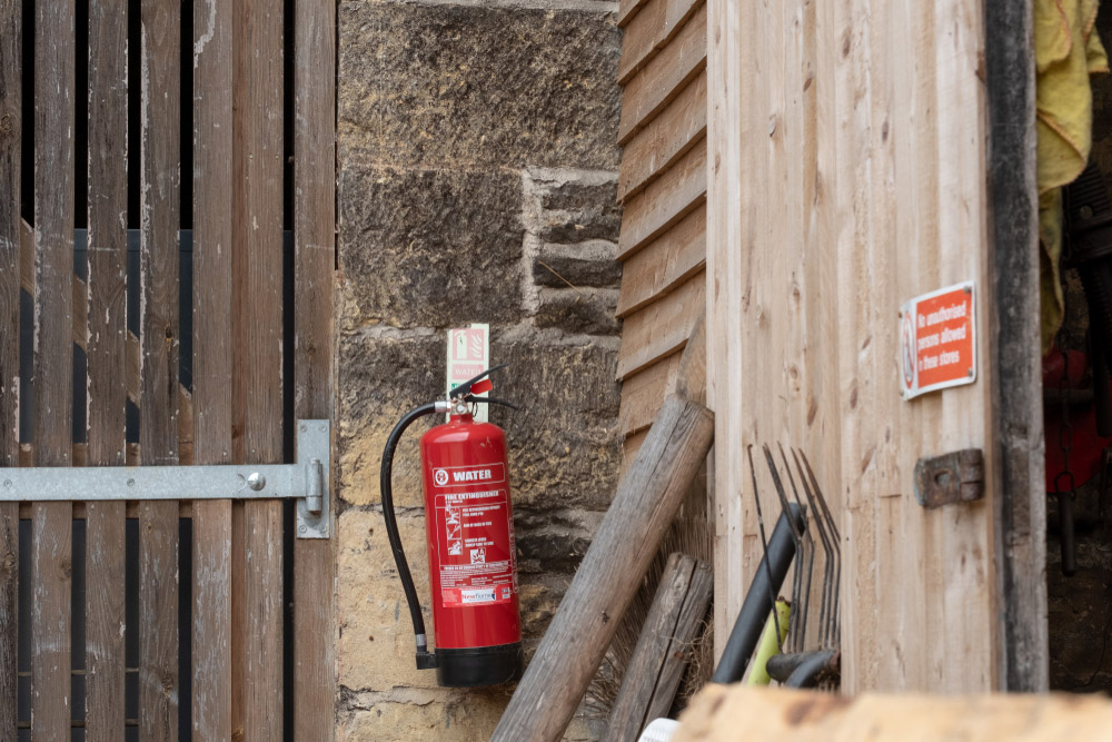 fire extinguisher attached to the barn door