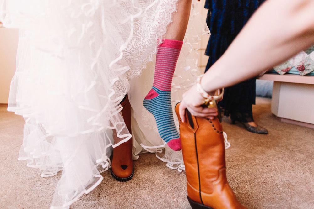 girl in socks wearing cowboy boots