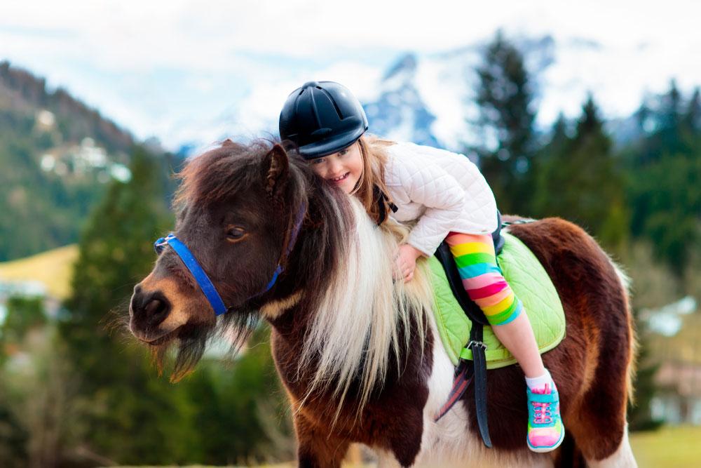 girl riding a pony