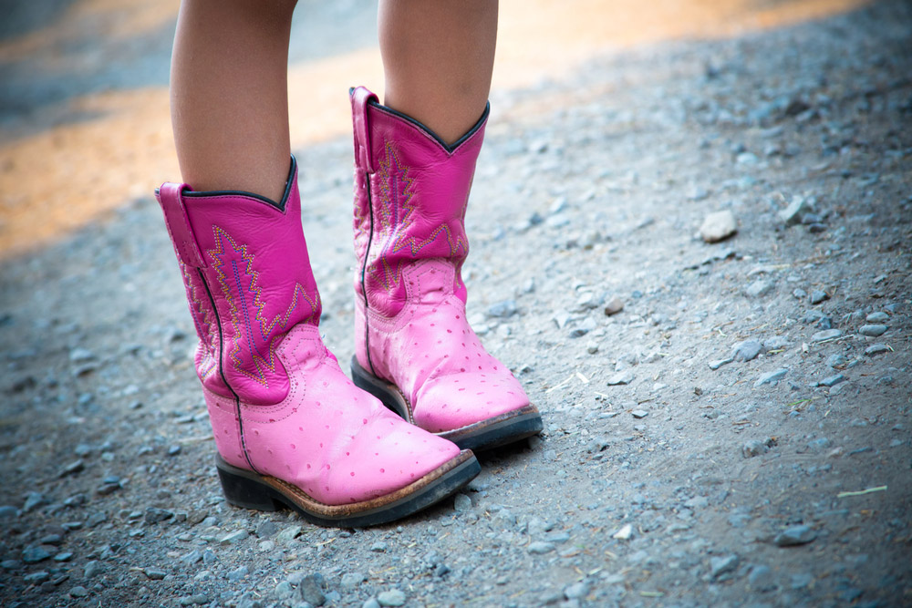 girl wearing pink cowboy boots