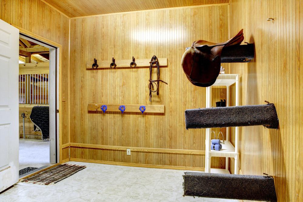 horse riding equipment storage inside the barn