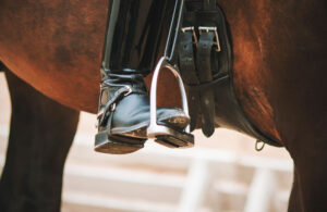 long calf boot on english stirrup