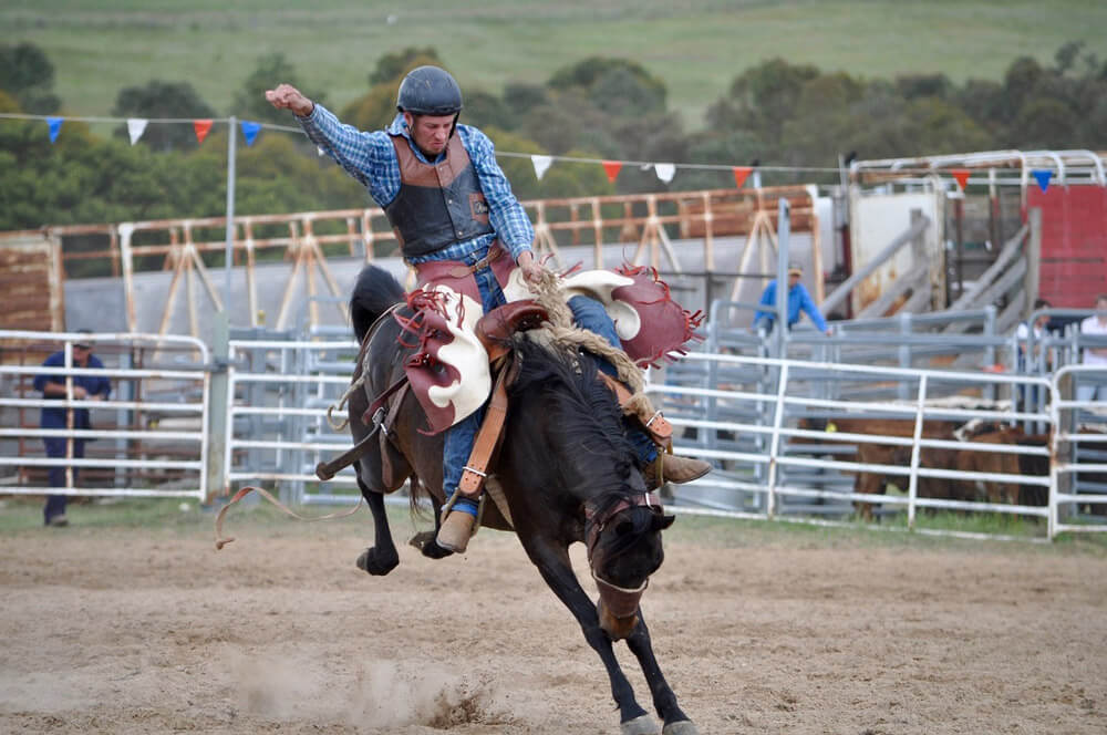 man in helmet barrel racing