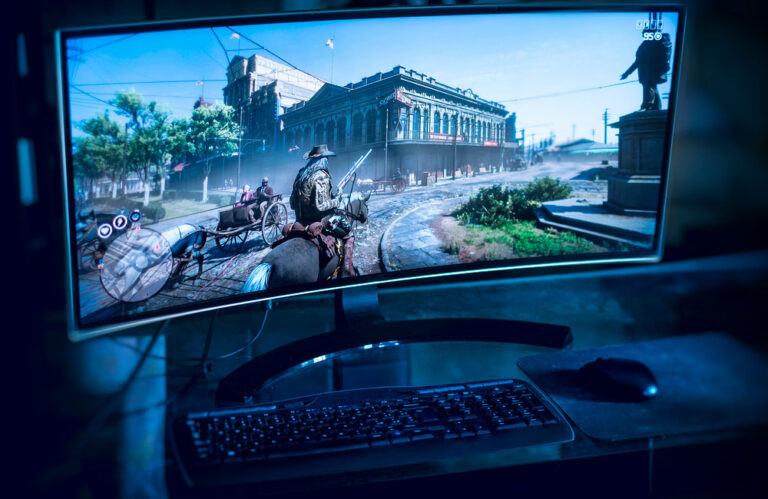 monitor with rdr2 game on screen