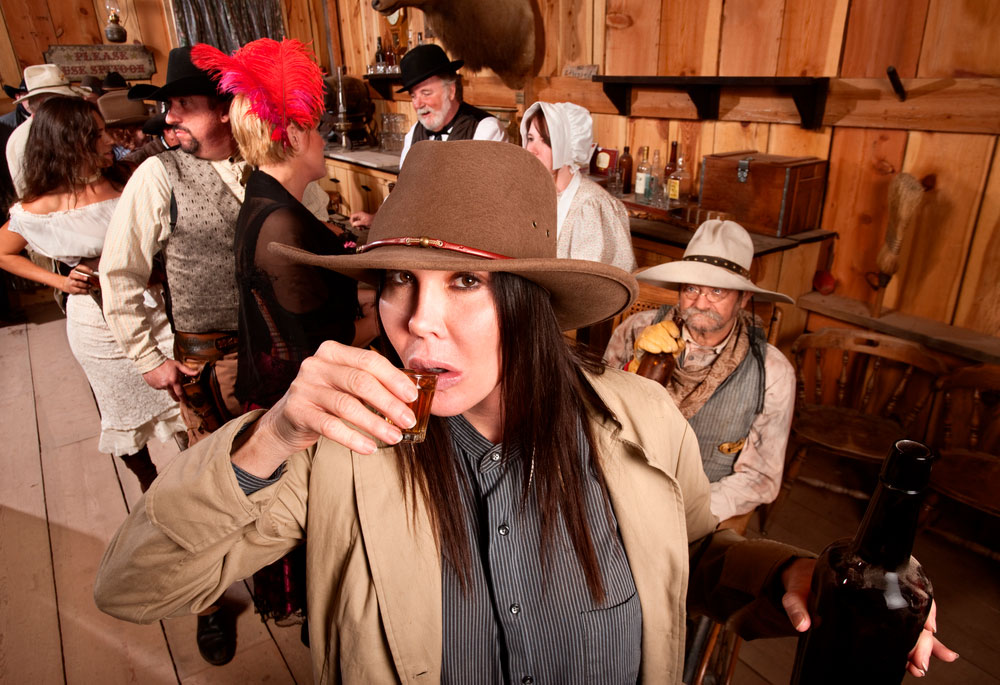 people partying in western costumes