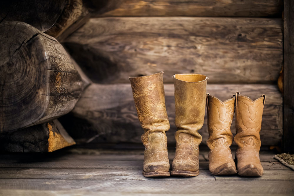 two pairs of leather cowboy boots
