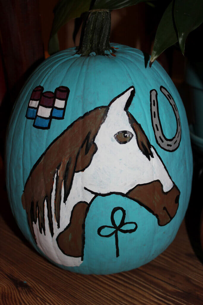 white horse with brown spots pumpkin painting