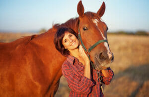 woman and horse are smiling