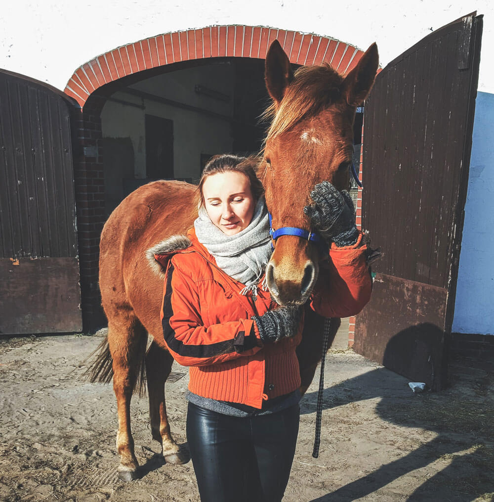 woman is hugging a horse