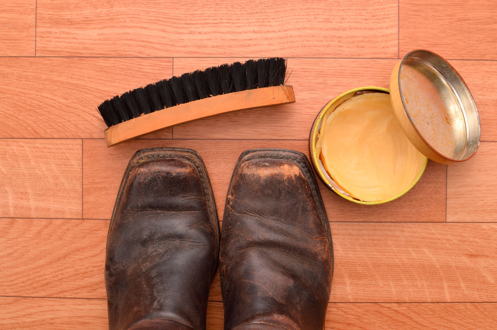 worn out boots and brush